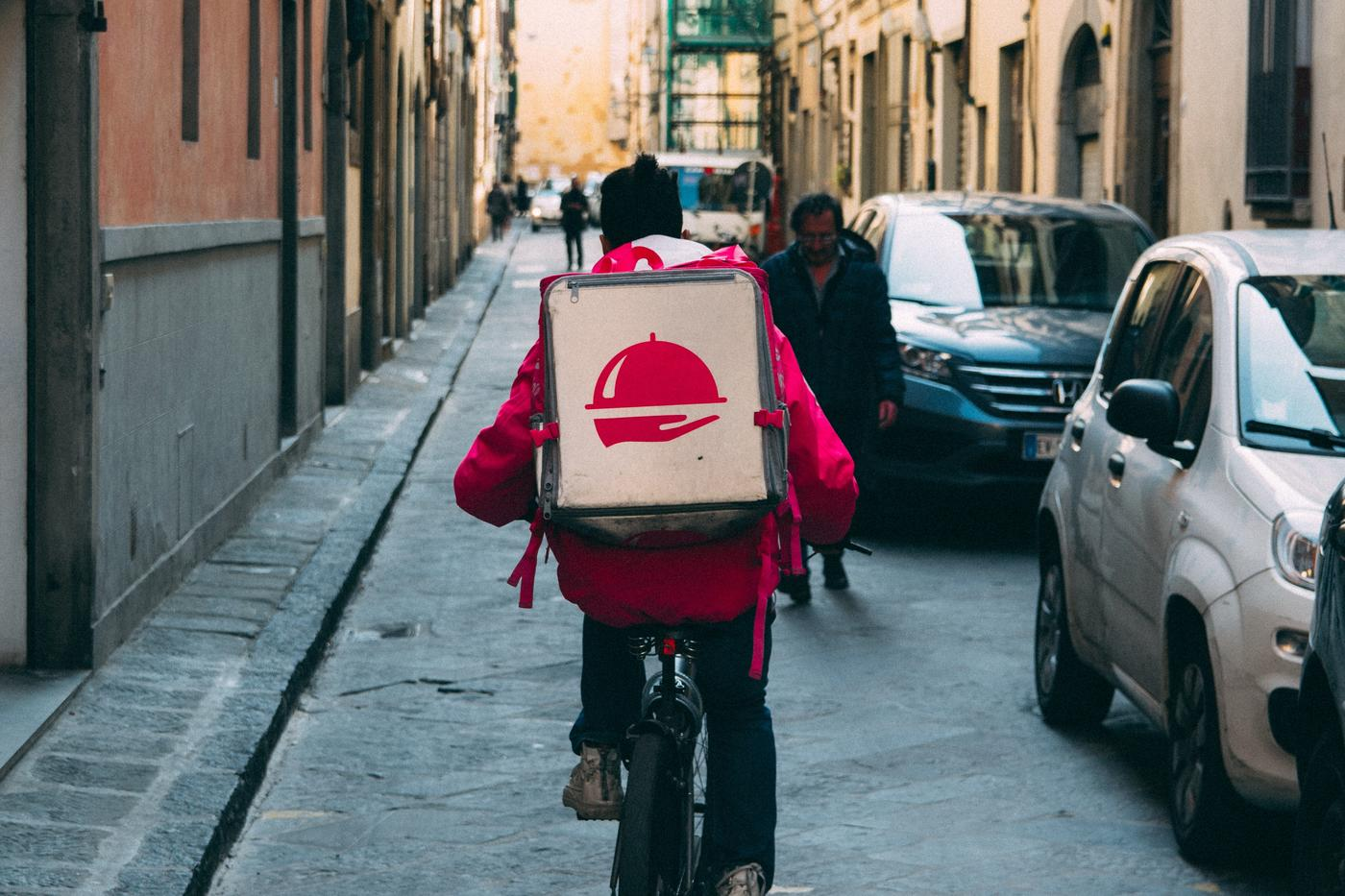 food delivery on a bike in a city